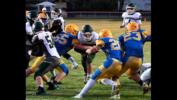 ART DENNISON (#88) punches through a hole in the middle for the Spartan's second TD in Friday's 36-13 loss to Harrison.--Journal Photo