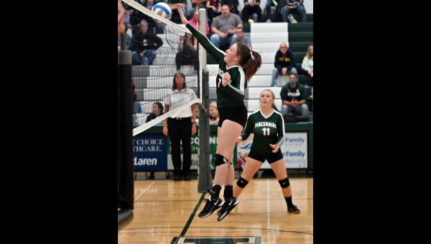 GEENA GAUTHIER (#7) drops the ball over the net for 1 of her 7 kills against Shepherd in the Spartan's 3-2 win over the Bluejays last Wednesday.    --Journal Photo