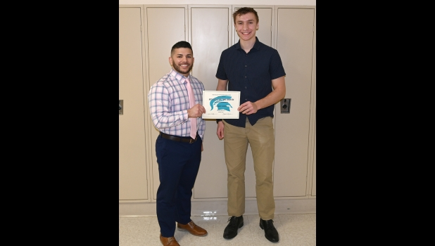 "ZACHARY JOHNSON receives his award as High School Spartan of the Month for November from Principal Kyle Woodruff. In nominating Zach, Mrs. Papke said, ""He is the most polite and intelligent student!!!  I was struggling to bring my stuff in the school and he volunteered to help.  He is always pleasant to be around and a joy to have in class.""          	            						            --Journal Photo"