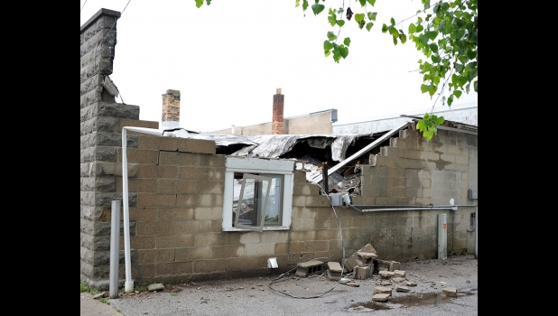 APPROXIMATELY HALF OF THE ROOF of the building at 229 S. Kaiser Street sits inside the building after collapsing in the early hours of Monday, June 10, 2019.                                --Journal File Photo