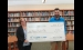 Jeffery Giddings (right) accepts a grant of $3,150.00 from Dawn Hoder of the Northern Bay County Fund for the Pinconning unit of the Boys & Girls Clubs of Great Lakes Bay Region to install a burglary and security camera system.   --Courtesy Photo