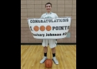 ZACH JOHNSON was honored after Thursday's 49-28 District Semi-Final win over Harrison. Johnson became the first Pinconning Boys Basketball player to reach 1,000 points.		          --Courtesy Photo