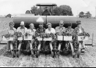 """This happy crew of vegetable farmers are hard at work transplanting peppers! Henry Hribek in the tractor pulling the transplanter with the """"planters"""" L to R: Mary Jane Hribek, unknown, unknown, Ronnie Hribek, Vivian O'Laughlin, unknown, Judy Monsion and Betty Monsion. Circa 1970's                                                        --Journal Archive Photo"""