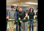 "DEREK LABEAN, founder of Smoky Ridge Outfitters, cuts the ribbon at the Saturday Grand Opening of their first retail location, inside Able Safe of Pinconning's new ""More of Michigan"" retail operation.             --Courtesy Photo"