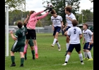 CARTER COUTCHER (#1) robs the Shepherd player of a header on a corner kick in the Spartans 0-7 loss on Monday afternoon. Coutcher made 21 saves in the effort.  --Journal Photo