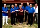 Prince of Peace Parish Council 3505 of K of C members: (l to r) Bernard Knoppe, Grand Knight Arthur Cornejo, Stanly Leavitt, Shannon Forshee Executive Director of Camp Fish Tales, Deputy Grand Knight Greg Petrimoulx, Gerald Rivard, Roy DeLorge, and District Deputy Raymond Skrabut.         --Courtesy Photo