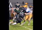 TYLER BROOKS (#36) grabs the Hornet's ball-carrier behind the line in Friday's Homecoming loss to Harrison.           --Journal Photo